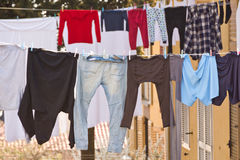 Washing lines with clothes drying Stock Photos