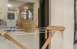 Washing lines with wooden clothespin in rattan basket. Close up washing lines with wooden clothespin in rattan basket stock photography