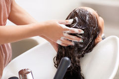 Washing hair Stock Photo