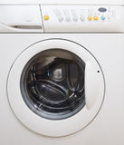 Washing machine. White drum washing machibe with dials and opening on front Royalty Free Stock Photo