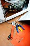 Washing machine. Repair of washing machine, screwdriver Royalty Free Stock Images