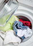 Washing machine. With colorful clothes inside Royalty Free Stock Images
