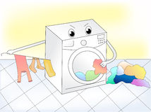 Washing machine. Washing clothes in the bathroom Royalty Free Stock Images
