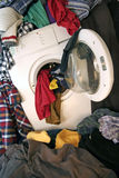Washing machine. And lot of dirty clothes Stock Photo