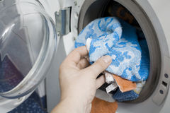 Washing machine. A fully loaded washing machine Royalty Free Stock Image