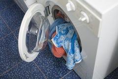 Washing machine. A fully loaded washing machine Stock Image