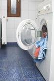 Washing machine. A fully loaded washing machine Stock Images