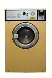 Washing Machine. A dirty well used coin operated launderette washing machine stock photo