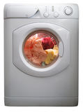Washing machine. Isolated on white full with laundry Stock Image