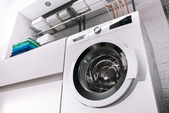 Washing Machine. In bathroom, with towels Royalty Free Stock Image