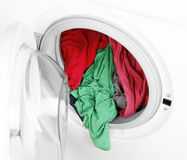 Washing machine with clean colorful clothes Royalty Free Stock Photography