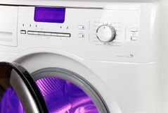 The washing machine - a close up of the display, the manhole and a choice of programs.  Stock Images