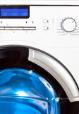 The washing machine - a close up of the display, the manhole and a choice of programs.  Royalty Free Stock Photos
