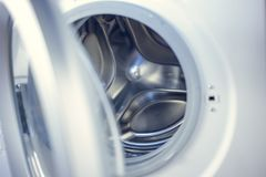 Washing machine - close-up. The texture of the drum. Door.  Royalty Free Stock Image