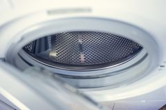 Washing machine - close-up. The texture of the drum. Door.  Royalty Free Stock Photos
