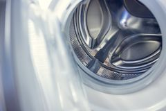 Washing machine - close-up. The texture of the drum. Door.  Stock Image