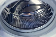 Washing machine - close-up. The texture of the drum. Door.  Stock Photo