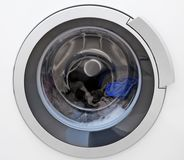 Washing machine with clothes, closeup. Laundry day Royalty Free Stock Photo