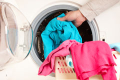 Washing machine with colorful clothes Stock Photography