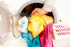 Washing machine with colorful clothes Royalty Free Stock Photo