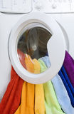 Washing machine and colorful laundry to wash Royalty Free Stock Photos