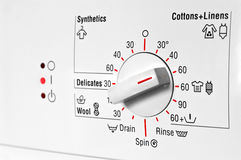 Washing machine control panel. Front control panel of white washing machine Royalty Free Stock Photo