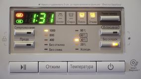 Washing machine control panel. the timer of the washing machine. stock video footage