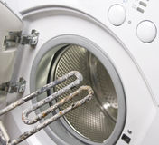 Washing machine and damaged heater Royalty Free Stock Image