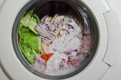 Washing machine door. With rotating garments inside Stock Photo