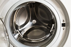 Washing machine drum. Photo of the interior of a wasging machine Royalty Free Stock Image
