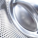 Washing machine drum background Stock Photo