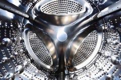 Washing machine drum closeup. Shiny steel background Royalty Free Stock Photography