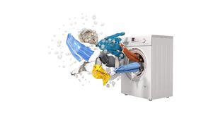 Washing machine and flying clothes on white background no shadow. Washing machine and flying clothes on white background Royalty Free Stock Photos