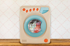 Washing machine in front of retro wallpaper Stock Photos