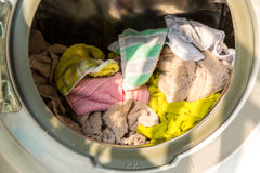Washing machine full. Of dirty clothes, closeup Royalty Free Stock Photos