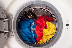 Washing Machine Full Of Dirty Clothes. Royalty Free Stock Photo