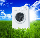 Washing machine and green  field Stock Photos