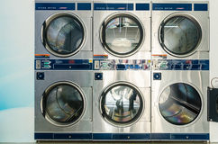Washing Machine. Laundry washing machines spinning clothes at laundry shop Royalty Free Stock Photography