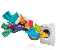 Washing machine with laundry on white background Stock Photo