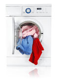 Washing machine with linen Stock Images