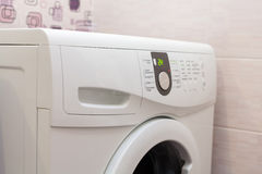 Washing machine loaded with clothes close-up. Royalty Free Stock Photography