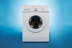 Washing Machine Over Blue Background Stock Photography