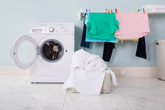 Washing Machine With Pile Of Cloth In The Basket Stock Photography