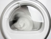 Washing machine porthole closeup working front view stock images