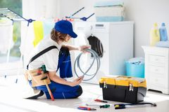 Washing machine repair technician. Washer service Royalty Free Stock Photos