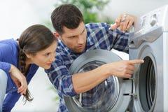 Washing machine repair technician stock photography