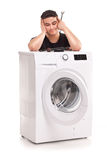 Washing machine repairman Royalty Free Stock Photos
