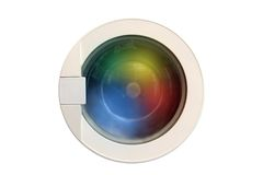 Washing machine running. With colorful cloths Stock Photos