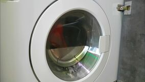 Washing machine is spinning. Household closed stock video footage