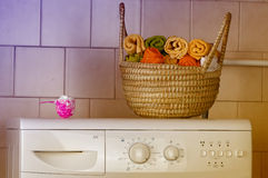 Washing machine with towels in basket Royalty Free Stock Images